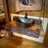 Natural edge wood vanity with copper sink