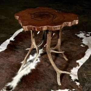 Rustic antler table and cow hide rug