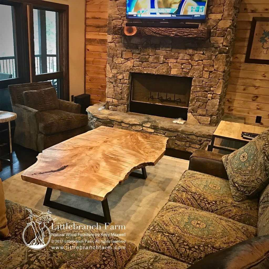 Rustic coffee table in front of fireplace.