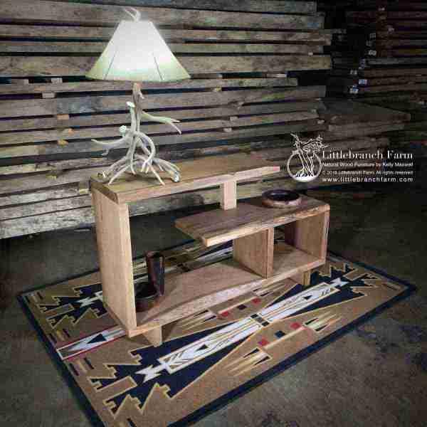 Wood sofa table on southwest rug.