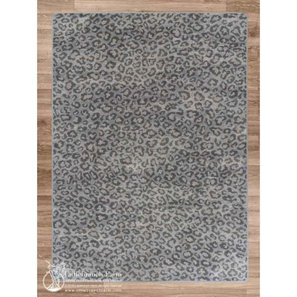 Snow leopard area rug