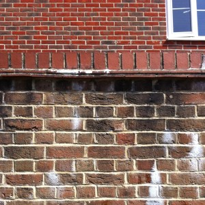 A picture of walls with different brick patterns