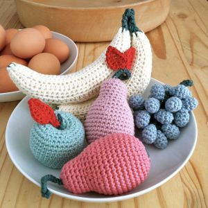 Hand-crocheted fruit arrangement in pastel colours