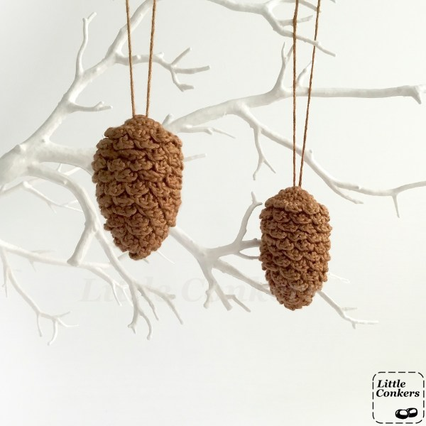 Hanging pine cone ornaments on a twig tree