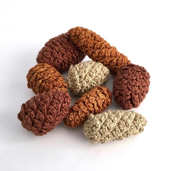 Crocheted fir cone ornaments in bamboo yarn