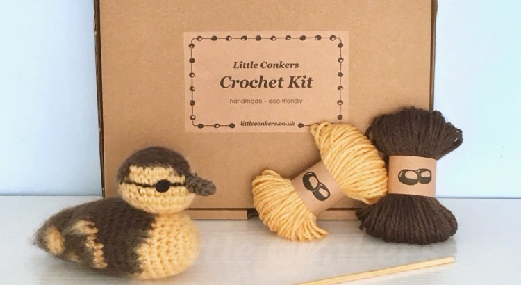 Crochet kit to make a mallard duckling in a brown box