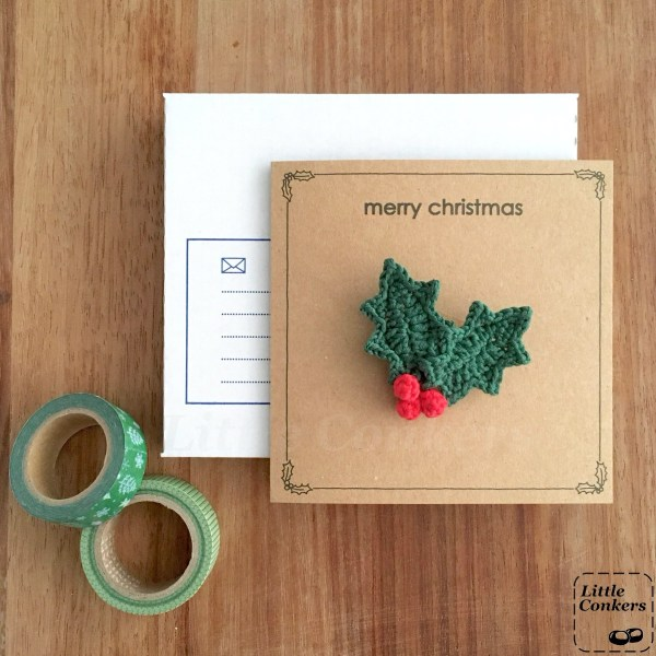 Recycled Christmas card with holly sprig brooch