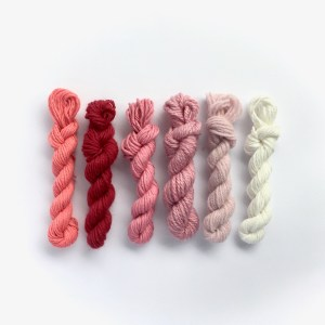 Mini yarn skeins in shades of pink and red
