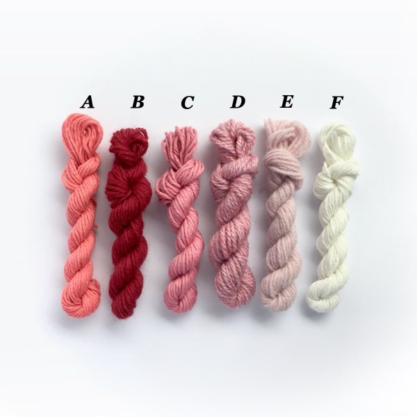 Mini yarn skeins in shades of pink and white