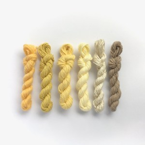 Mini yarn skeins in shades of yellow and cream
