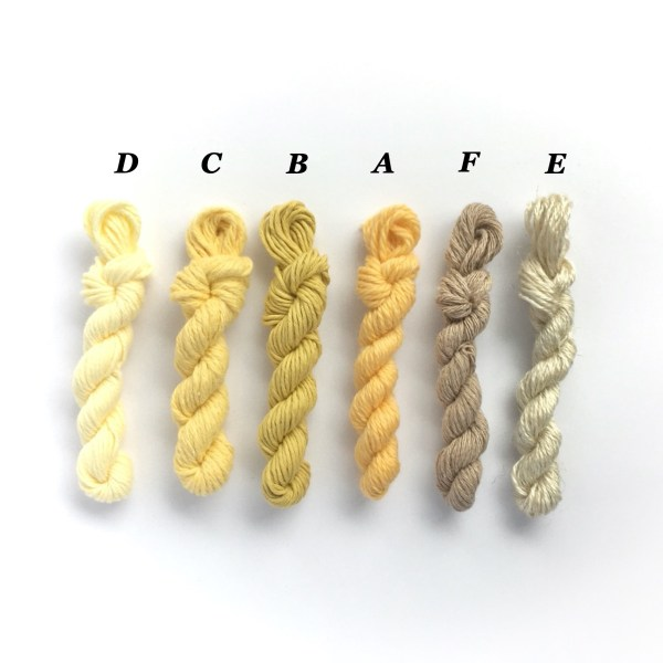 Mini yarn skeins in shades of yellow and beige