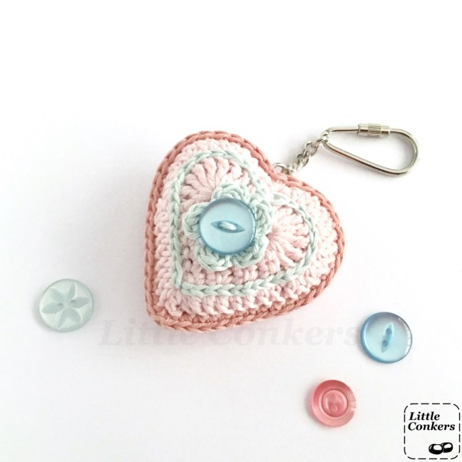 Pink and blue crocheted heart keyring