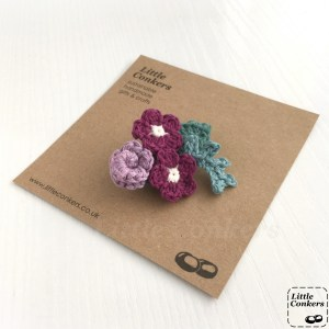 Crocheted flower bouquet brooch in purple and green