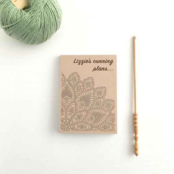 Recycled notepad with kraft brown cover and black line drawing