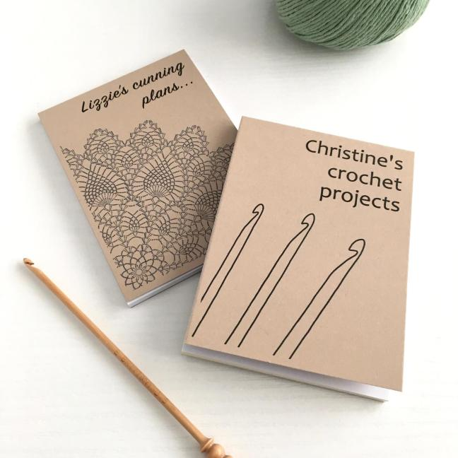 Small notepads with crochet designs on the covers