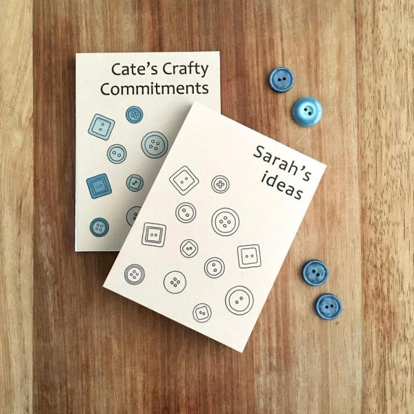 Small recycled notepads with buttons designs on covers