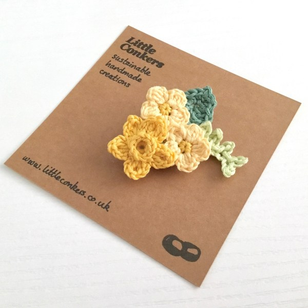 Crocheted bouquet brooch with spring flowers in yellow and green