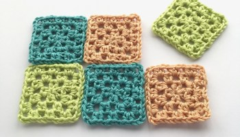 Mini crocheted granny squares with htr or hdc