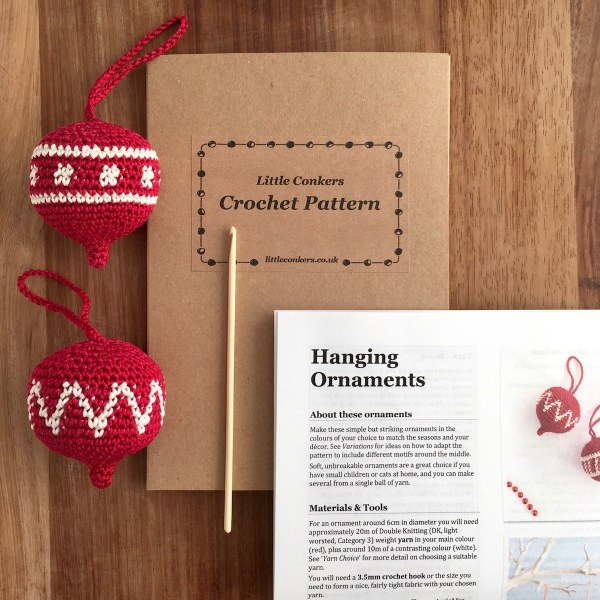Printed crochet pattern for Christmas ornaments in a kraft folder