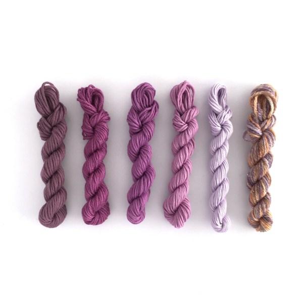 Mini yarn skeins in shades of purple