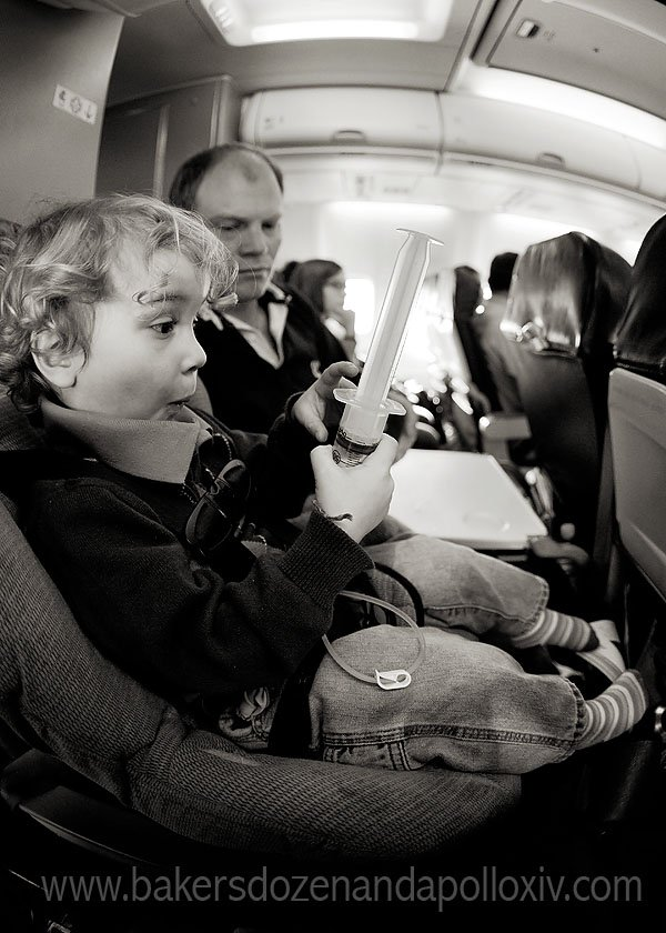 toddler being tube fed on airplane (g-tube)