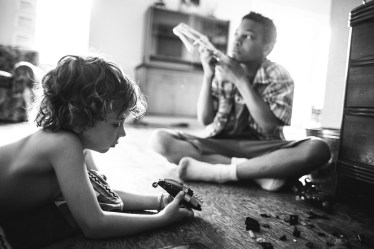 black and white image of brothers playing together