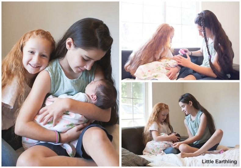 big sisters holding newborn baby - bellingham newborn photographer