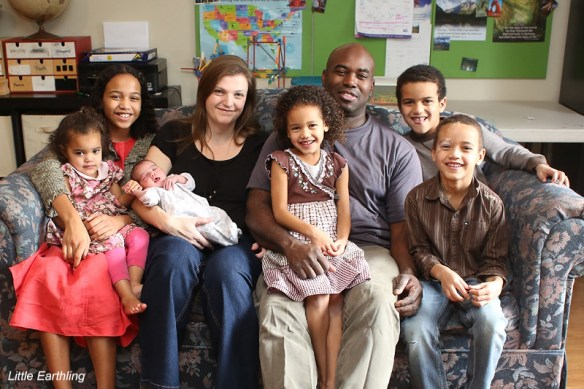 lifestyle family portrait of multiracial family