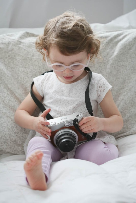Elaina loved playing with my Instax camera during Aria's newborn session. Bellingham newborn Photographer
