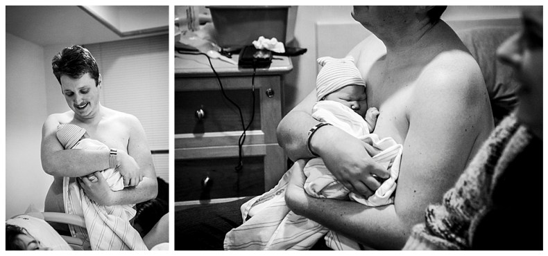 Dad holds his newborn baby for the first time.