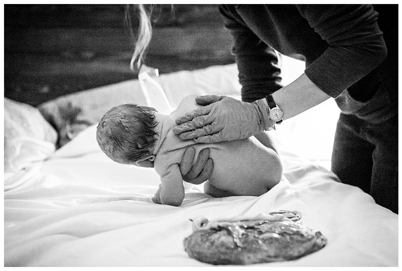 Newborn exam done by midwife after a beautiful home birth in Bellingham.