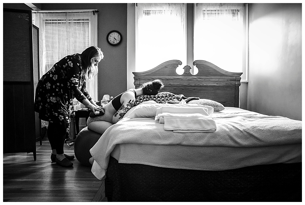 Mother comforting daughter during labor. Woman laboring at birth center. Bellingham birth photography by Little Earthling Photography.