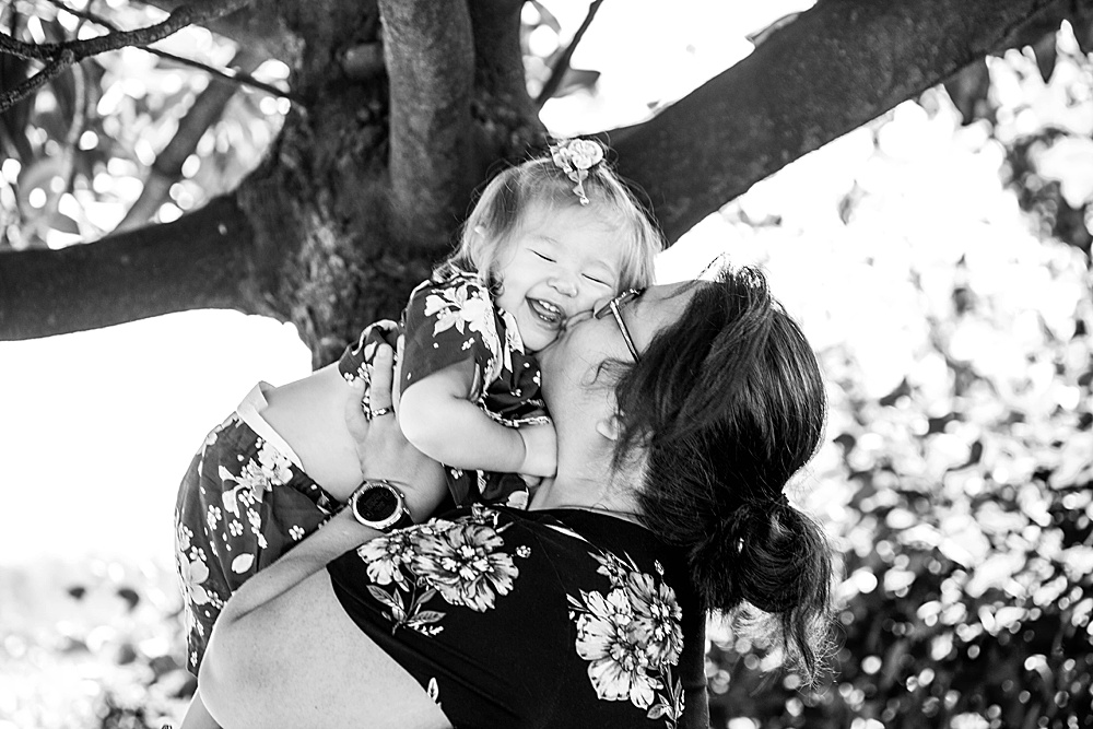 Mama kissing baby at milestone session. Bellingham Photographer.