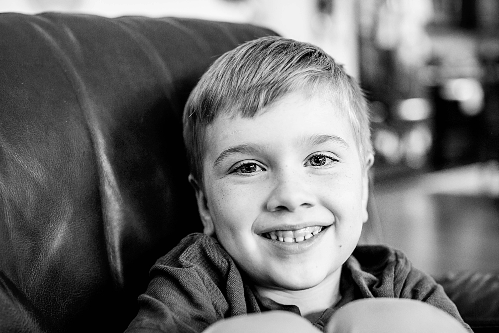 Smiling boy in black and white. Bellingham Photographer. In-home portrait session.