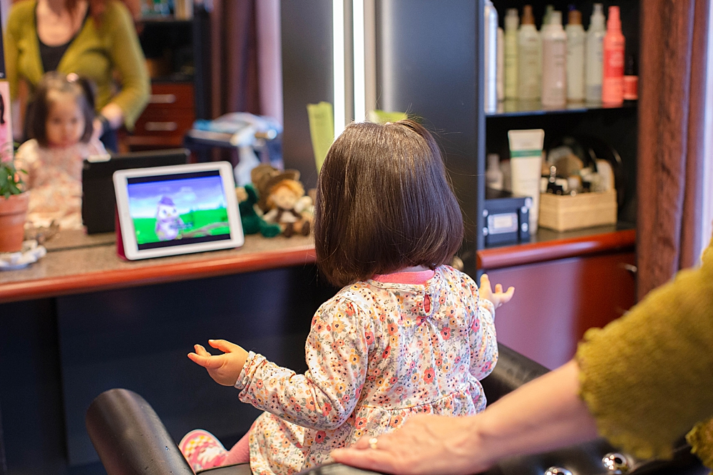 Toddler getting haircut Sandalwood Salon downtown Bellingham.