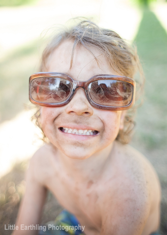 smiling boy in sunglasses