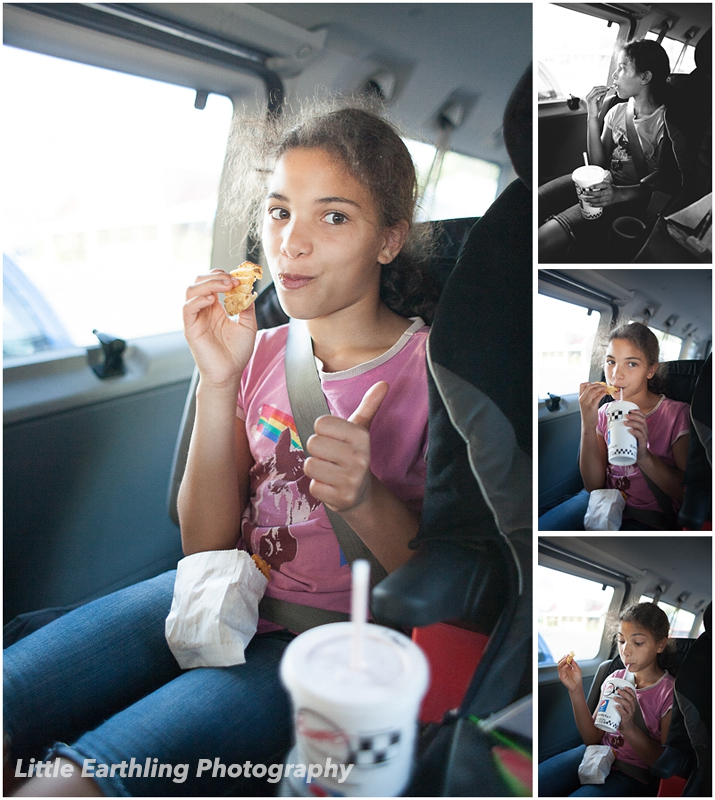 Girl eating at Boomer's drive-in