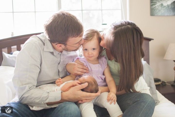 Parents and toddler with newborn baby. Little Earthling Photgraphy
