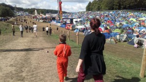 Auntie Ruthie and Noah walk through the Leeds Festival campsite.