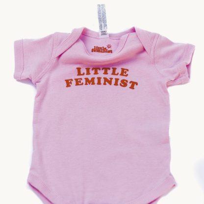 Little Feminist pink onesie inside label