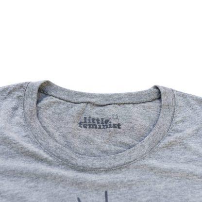 Raising Little Feminists grey women's shirt inside label