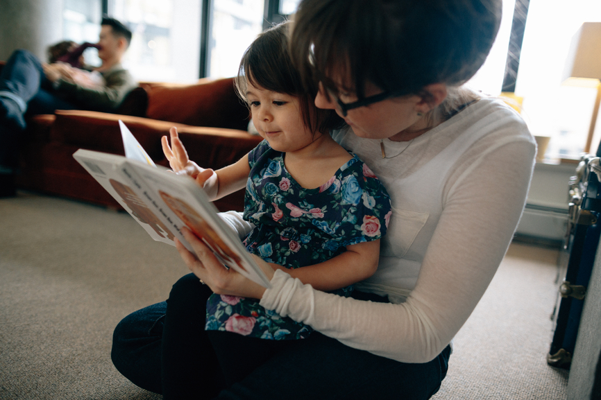 reading classic feminist book with toddler