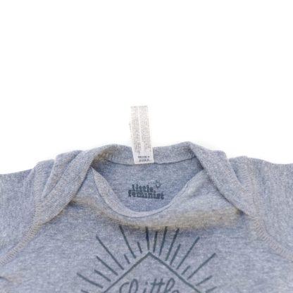 Little Feminist grey onesie inside label