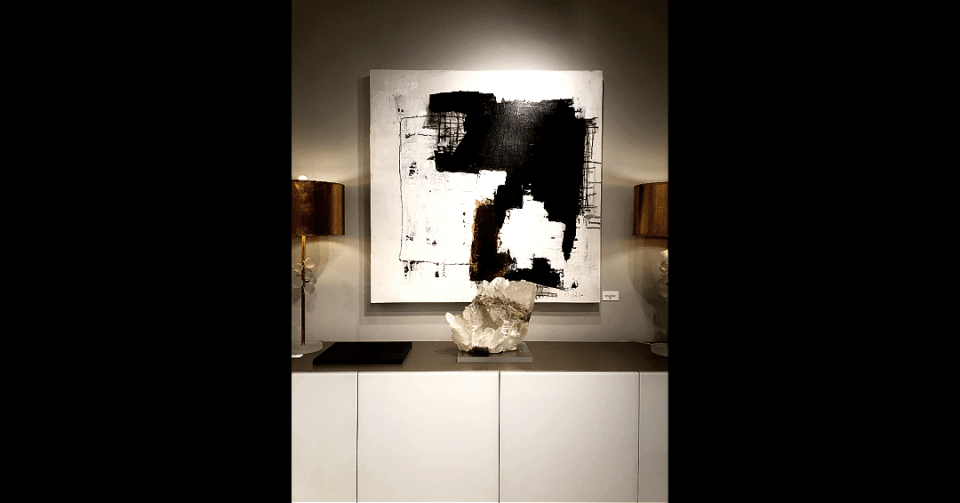 white abstract painting in showroom