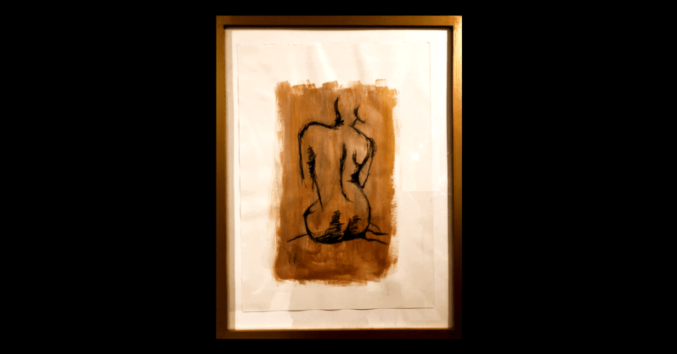 gold sitting nude painting in gold matte frame