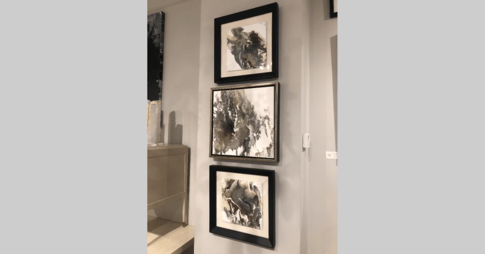 framed marble abstract 1 displayed in showroom with other artwork by Stephanie wheeler