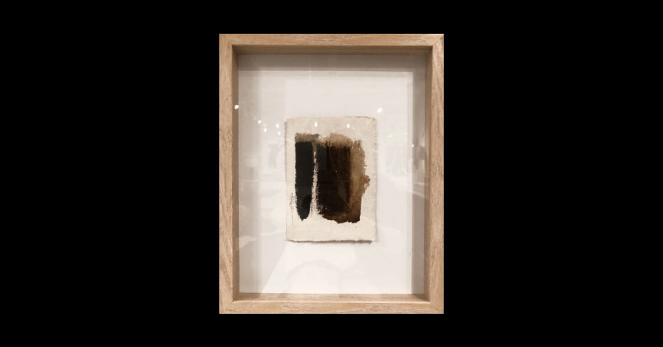brown shadowbox collage in wood shadowbox frame