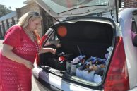 Annaline De Wet driving packing and coordinating deliveries