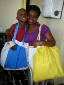 Mom & Little Fighter with their Bags of Hope