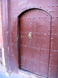 Door knockers with The Hand (Khamsa), to protect against the evil eye, are common in Morocco.